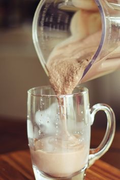 "Protein Mocha ""Frappuccino""  1 Scoop coffee or chocolate flavored protein powder  1 packet instant coffee grounds  1 cup unsweetened chocolate almond milk (you could also use coffee)   1 tablespoon unsweetened baking cocoa (optional)  1 cup ice   Blend and enjoy! =)"