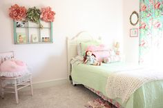 A peek into Amelia's Big Girl Room on our blog today!  #vintage  #garden #floral #toddler #bedroom