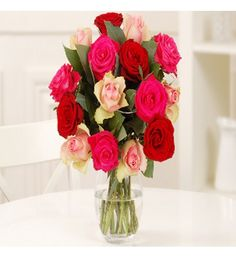 This angelically beautiful bouquet is a modern twist on the classic Valentine's bouquet. Stunning deep red roses are contrasted with vivid cerise roses and delicate palest pink roses and lovely silvery-green eucalyptus foliage completes this charming bouquet that will send your message of undying love and affection without the need for words.