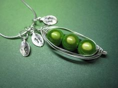 $24 pea pod necklace - how sweet! OMG would be great to represent my boys!