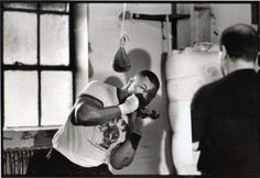 Mike Tyson, performing bobbing and weaving drills, under the watchful eye of Kevin Rooney..