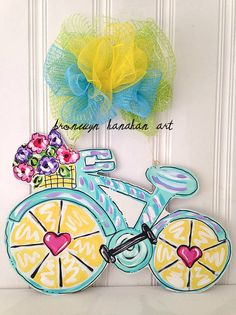 Bicycle Door Hanger    Item is hand painted + sprinkled with glitter. Item is made of wood + sealed with a protective finish, so it will work