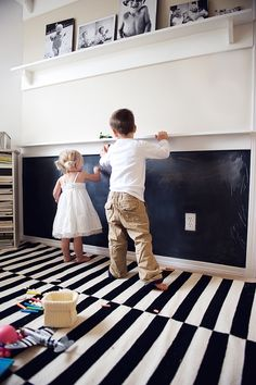 Chalkboard wall and chalk shelf above! And CUTE picture shelves at the top!