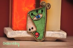 Felt and zipper abstract face by GalleeValley, via Flickr