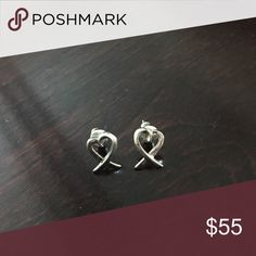 Tiffany & Co. Paloma Picasso Loving Heart Earrings Authentic and timeless Tiffany & Co. sterling silver earrings! worn 3 times max! about 1/2 inch tall, perfect dainty yet noticeable earrings for everyday wear. Tiffany & Co. Jewelry Earrings