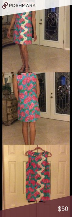 Lilly Dress Firecracker Print shift. Embellished down the left front. Cotton fabric and lined.  Shades of pink, green and blue background. Lilly Pulitzer Dresses