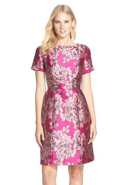 Free shipping and returns on Adrianna Papell Embellished Jacquard Sheath Dress at Nordstrom.com. Superbly tailored jacquard shimmers as metallic details illuminate oversized blooms on this elegant sheath dress. A coordinating tab attached with glitzy embellished buttons highlights the waist and adds even more glamour to this party frock.