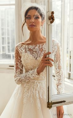 Long sleeves ball gown wedding dress with Crystal Embellishments on lace bodice and tulle skirt | Luce Sposa Wedding Dresses 2021- Charlotte - Belle The Magazine #weddingdress #weddingdresses #bridalgown #bridal #bridalgowns #weddinggown #bridetobe #weddings #bride #dreamdress #bridalcollection #bridaldress #dress See more gorgeous bridal gowns by clicking on the photo