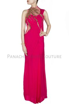 The fuschia pink designer saree gown is feature in gorgette fabric with golden hand embroidered blouse and is available online on discounted price for a limited period.