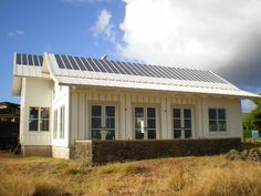 metal houses | Uni-Solar house with PVL Laminants and metal roofing.