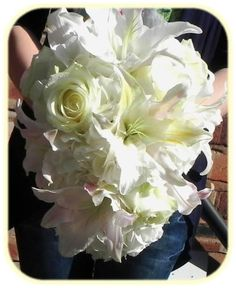 Soft romantic cascading bouquet - White lilies, white roses and white hydrangea with a hint of pink