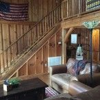 Great room with barnwood walls and rough-sawn beams throughout