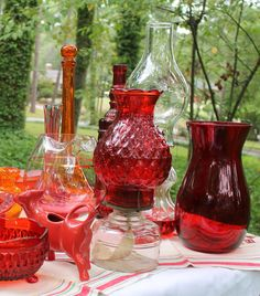 Great red glassware and oil lamps, great for retro weddings