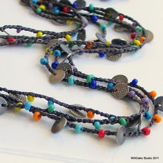 Beaded Crochet Necklace or Cuff, Multi-strand Silk with Antiqued Silver Disks and Multicolored Glass, Long Silk Chain. $34.00, via Etsy.