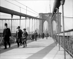 Commuters walking across the Brooklyn Bridge to Manhattan in the early 1900s #nycphotography #vintagephotos #blackandwhite - $12.95
