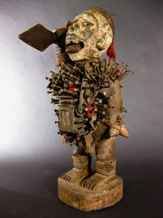 Evidence of use and cracks due to age or drying. HAND CARVED FROM ONE PIECE OF WOOD. D. R. CONGO. THE TORSO IS STUDDED WITH NAILS AND METAL BLADES LITTERED WITH MAGIC PARAPHENALIA TO ENHANCE ITS POWER. | eBay! Tribal African, African Art, Voodoo Magic, African Sculptures, Yoruba, Aboriginal Art, Boro, Anthropology, Mask Design