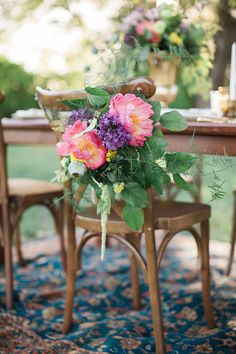 coral charm peony chair decor - photo by Sharon Litchfield Photography http://ruffledblog.com/handcrafted-bohemian-bridal-shoot