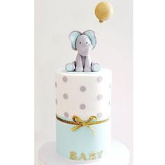A closer look at the cute little baby shower cake for Jacklen. The height of this beauty was 11 inches!! #cakes2cupcakes #sugarart #babyshower #cake #sydneycakes #babyelephant #glitter