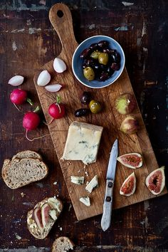 Antipasti Platter: figs, crusty bread, blue cheese, seasoned olives, and radishes (and maybe some honey?). Serve with Prosecco.
