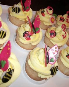 Butterfly Cupcakes - SweetMarvels made these impressive butterfly cupcakes using a base of vanilla butter cupcakes frosted with vanilla buttercream. The butterflies, bees, flowers, and numbers are made from homemade marshmallow fondant and are entirely edible.