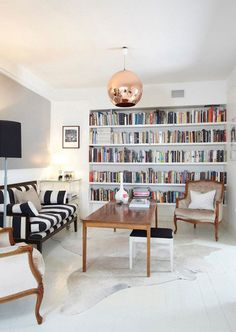 Love the striped couch and the copper fixture.