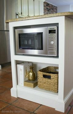 KITCHEN:  Eliminating the need to mount in upper cabinets or lie on the counter, I LOVE this.  Built in island with microwave shelf.