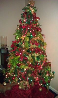us green christmas tree with gold and red decorations home design