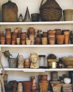 white shelves with various baskets and terracotta pots displayed via @thefuturekept. / sfgirlbybay