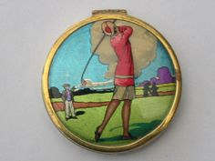Art Deco foil top powder compact with female golfer (past Decogirl stock)