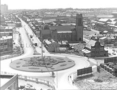 Tray Uru: MCL/4/4 Black and white photograph showing the roundabout near St Thomas' Church, Westfield Street, St.Helens 1974. .......................MCL - Clare Collection 4 - Black and white photographs taken from Beecham's Tower, St.Helens