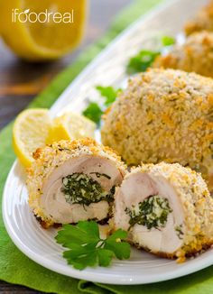 Healthy Spanakopita Chicken Roll Ups Recipe - easy to roll, no toothpicks, clean chicken recipe. Melted cheese with garlic herbs inside, juicy and tender meat with crunchy outside.