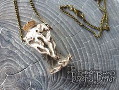 Handcrafted Bone Black Moss Singing Quartz by TheTwystedBriar Handcrafted Bone White Skeleton Leaf and opal Glass Vessel Pendant Necklace Mori Goth Dark Spooky Woodland Fantasy Jewelry Witchcraft Amulet