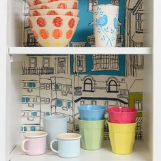 Line a kitchen cupboard with wallpaper to add a flash of colour every time you open it!
