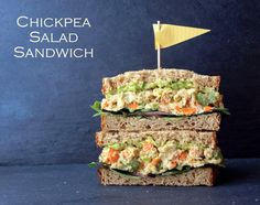 Mashed Chickpea Salad Sandwich  a few slices of your favorite bread leafy greens avocado, mashed (optional) 1 can (15 oz) chickpeas (garbanzo beans), drained and rinsed 1/2 cup celery, sliced  1/2 cup carrots, diced 1/4 - 1/3 cup scallions, sliced  1/4 cup or so hummus or tahini (any vegan mayo works too)* 1 - 2 T mustard  sea salt & cracked pepper, to taste dash of garlic powder juice of 1 lemon, optional small handful pepitos (pumpkin seeds), optional paprika/smoked paprika, garnish