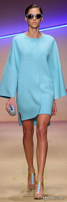 Laura Biagiotti Spring Summer 2015 Ready-To-Wear - deep turquoise sets the mood in this brilliant cocktail dress. Long sleeves are slightly flared out towards the end. gives the impression of a wrap skirt and has a little side-slit for sass.