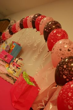 Baby shower for Adrianne string of pearl balloons over gift table