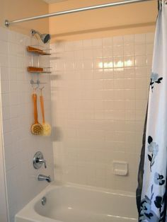 A Builder's Minimum Bathroom Gets a Maximum Makeover : The tiled shower was already a step- up from the basic fiberglass shower-tub combo that is usually found in a builder's standard. Because this area was in good working order and only devoid of color, new bath accessories were added to bring in warmth and a more luxurious feel. From DIYnetwork.com