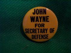 "JOHN WAYNE FOR SECRETARY OF DEFENSE OLD YELLOW  BUTTON PINBACK 1 1/4"""