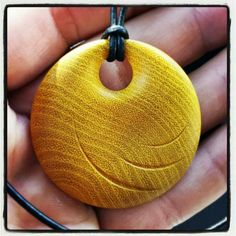 Wood pendant turned on a lathe. https://m.facebook.com/gcwoodstudio