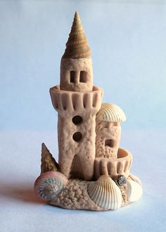 This miniature seaside sand castle tower is a one of a kind original design and creation by artist C. Rohal. It is completely hand made from mixed