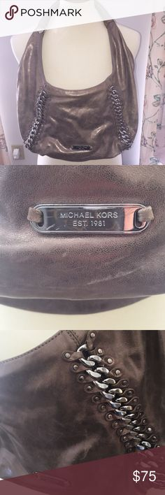 Michael Kors Hobo bag Beautiful chain detail adorns this soft metallic leather purse. Chain detail is in excellent condition. Lining is in good condition, with the exception of a hole inside of the lining in the seam (easy fix). Otherwise this purse is in good condition. I wore it a few times then gave it to my mom. She then gave it back to me! 💁‍♀️ Michael Kors Bags Shoulder Bags