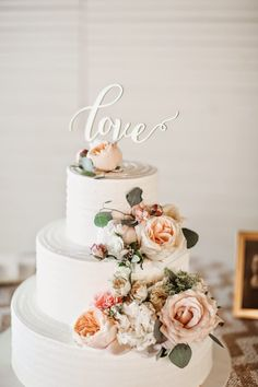 gorgeous soft pink and sage cascading flower wedding cake with love topper at Oregon Barn Wedding. Green Villa Barn just 10min from Salem Oregon