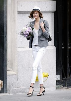 Karlie Kloss | white skinny jeans + black strapped heeled sandals + white shirt + gray blazer + fedora + shoulder bag
