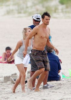 Josh Duhamel showed off his toned torso as he flaunted his shirtless bod on set with fellow actor Julianne Hough. BTW I think Josh and Juliane would make a cute couple.     The Transformers actor was seen frolicking shirtless on set with his co-star looking relaxed, while shooting scenes for their new film 'Safe Haven' in Southport. There are reports that the pair were seen laughing and joking between takes.