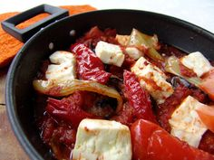 In Greece, we call 'saganaki' a frying pan with a handle on either side. It does sound a bit Japanese, but it isn't. Usually the handles are metal, because the cooking can be finished in the oven. There are many recipes using a saganaki, from chees