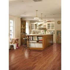 Vinyl wood plank flooring. Waterproof and wear-resistant. Great option for basement flooring. http://m.homedepot.com/p/TrafficMASTER-InterLock-5-45-64-in-x-35-45-64-in-x-4-mm-Old-Hickory-Nutmeg-Resilient-Vinyl-Plank-Flooring-22-66-sq-ft-case-184368/204336250/