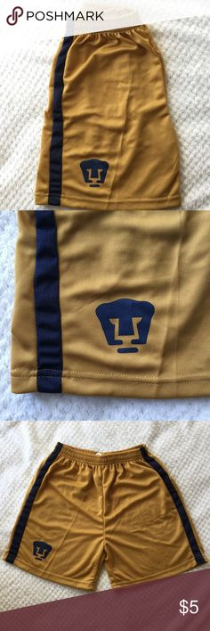 Pumas (UNAM) soccer shorts NWOT. Youth L, however they also fit as a women's small. gold Pumas shorts with navy blue stripes on each side. Never been worn. Bottoms Shorts
