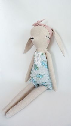 Bunny doll with hand embroidered features and hand painted cheeks