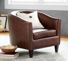 Pottery Barn's armchairs, occasional chairs, and accent chairs are comfortable and built to last. Find leather and upholstered armchairs in a range of styles. Upholstered Swivel Chairs, Swivel Armchair, Chair And Ottoman, Chesterfield, Style Cottage Anglais, Leather Furniture, Leather Chairs, Leather Sofas, Leather Recliner