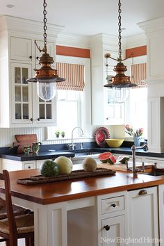 Mix of black granite and wood counters, red walls ~ Welcome Home | New England Home Magazine
